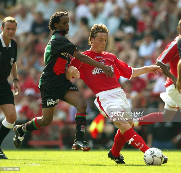 Charlton Athletic's Scott Parker and NEC Nijmegen's Youssouf Hersi battle for the ball