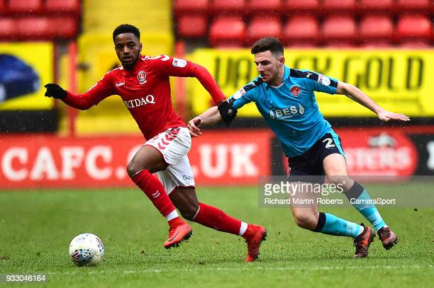 Charlton Athletic's Tariqe Fosu competes with Fleetwood Town's Lewis Coyle during the Sky Bet League One match between Charlton Athletic and...