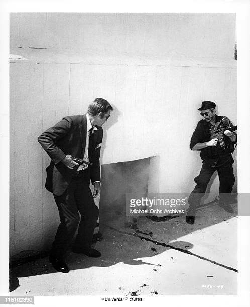 Charlton Heston and John Cassavetes follow a trail of blood in a scene from the film 'TwoMinute Warning' 1976
