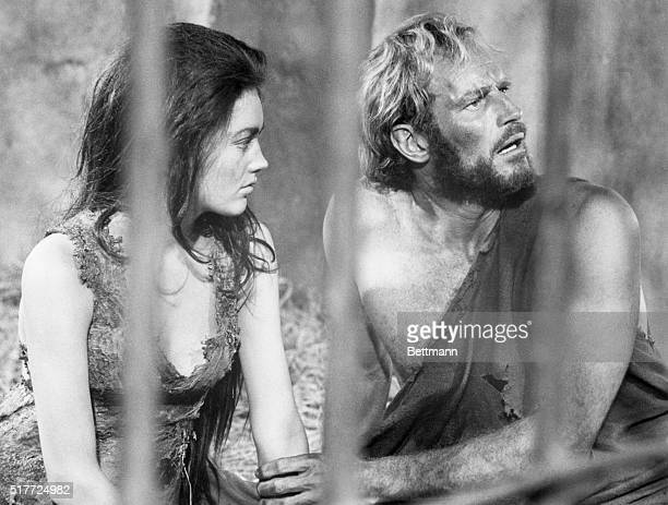 Charlton Heston and Linda Harrison appear together in the film Planet of the Apesin 1968