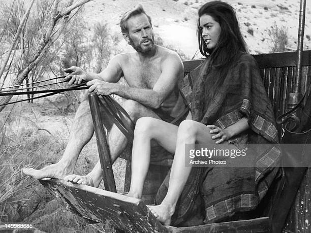Charlton Heston and Linda Harrison riding on coach together in a scene from the film 'Planet Of The Apes' 1968