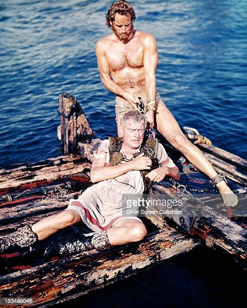 Charlton Heston as Judah Ben-Hur, and Jack Hawkins as Quintus Arrius, on a raft in a scene from 'Ben-Hur', directed by William Wyler, 1959.