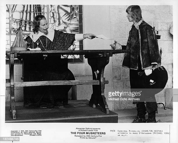 Charlton Heston attempts to make Michael York an ally in a scene from the film 'The Four Musketeers' 1975