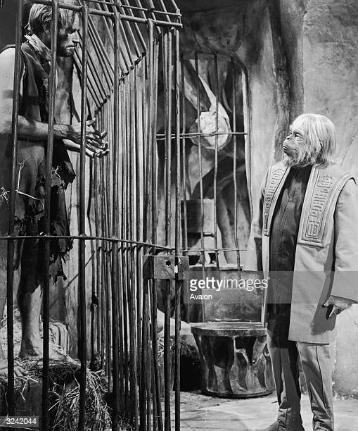 Charlton Heston finds himself the captive of Dr Zaius played by Maurice Evans in the scifi classic 'Planet of the Apes' directed by Franklin J...