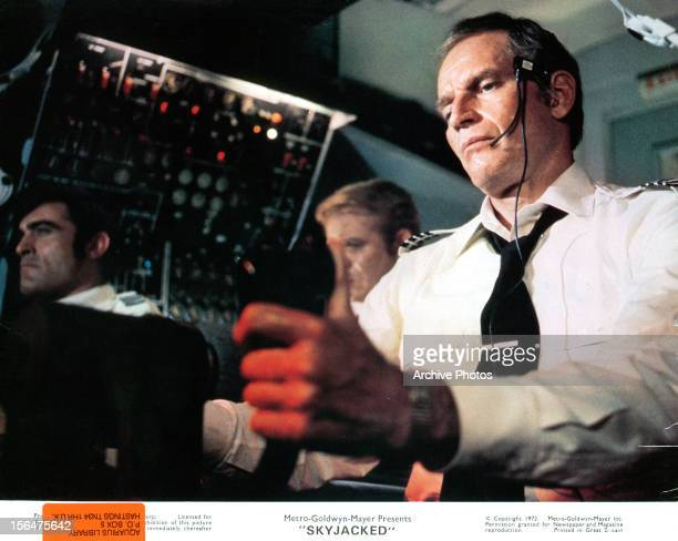 Charlton Heston flies a plane in a scene from the film 'Sky Riders' 1972