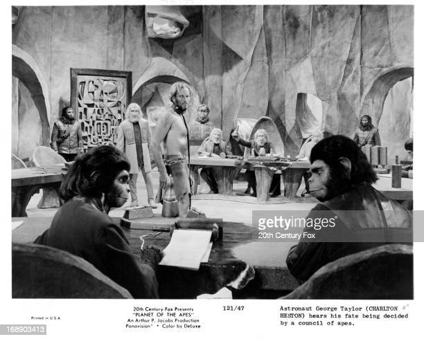 Charlton Heston hears his fate being decided by a council of apes in a scene from the film 'Planet Of The Apes' 1968