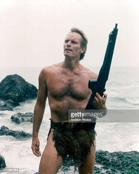 Charlton Heston holds a gun in a scene from the film 'Planet Of The Apes' 1968