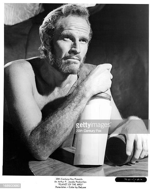 Charlton Heston holds a jar in a scene from the film 'Planet Of The Apes' 1968