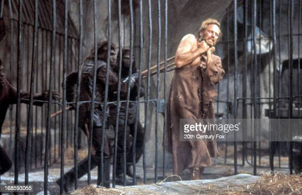 Charlton Heston is forced into a cage in a scene from the film 'Planet Of The Apes' 1968