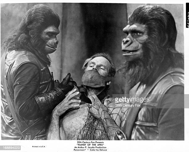 Charlton Heston is held captive in a scene from the film 'Planet Of The Apes' 1968