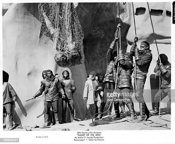 Charlton Heston is held in a net in a scene from the film 'Planet Of The Apes' 1968