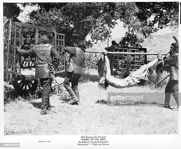Charlton Heston is led into a cage in a scene from the film 'Planet Of The Apes' 1968