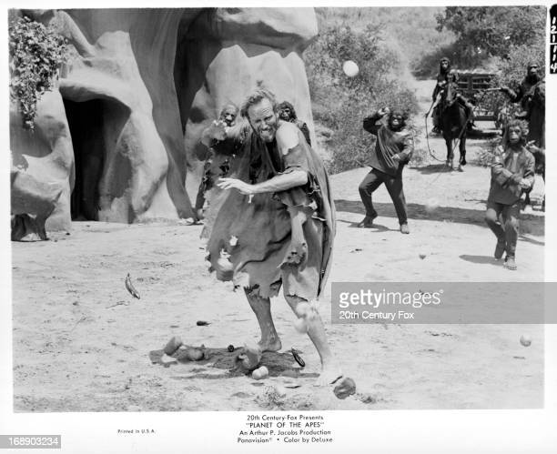 Charlton Heston is pelted with tomatoes by apes in a scene from the film 'Planet Of The Apes' 1968