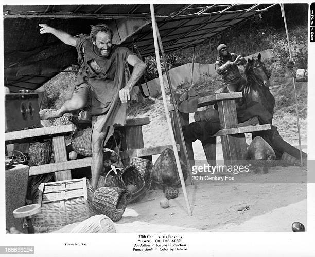 Charlton Heston on the run in a scene from the film 'Planet Of The Apes' 1968