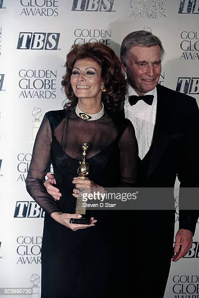 Charlton Heston presents Sophia Loren with the Cecil B DeMille Award at the Golden Globes