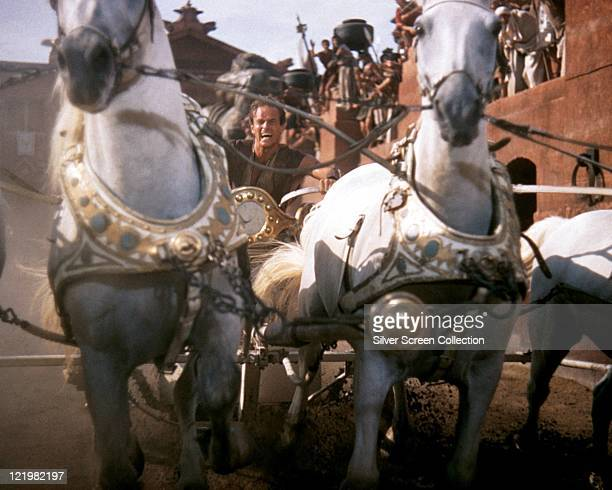 Charlton Heston US actor in costume and riding a horsedrawn chariot in a publicity still issued for the film 'BenHur' 1959 The historical drama...