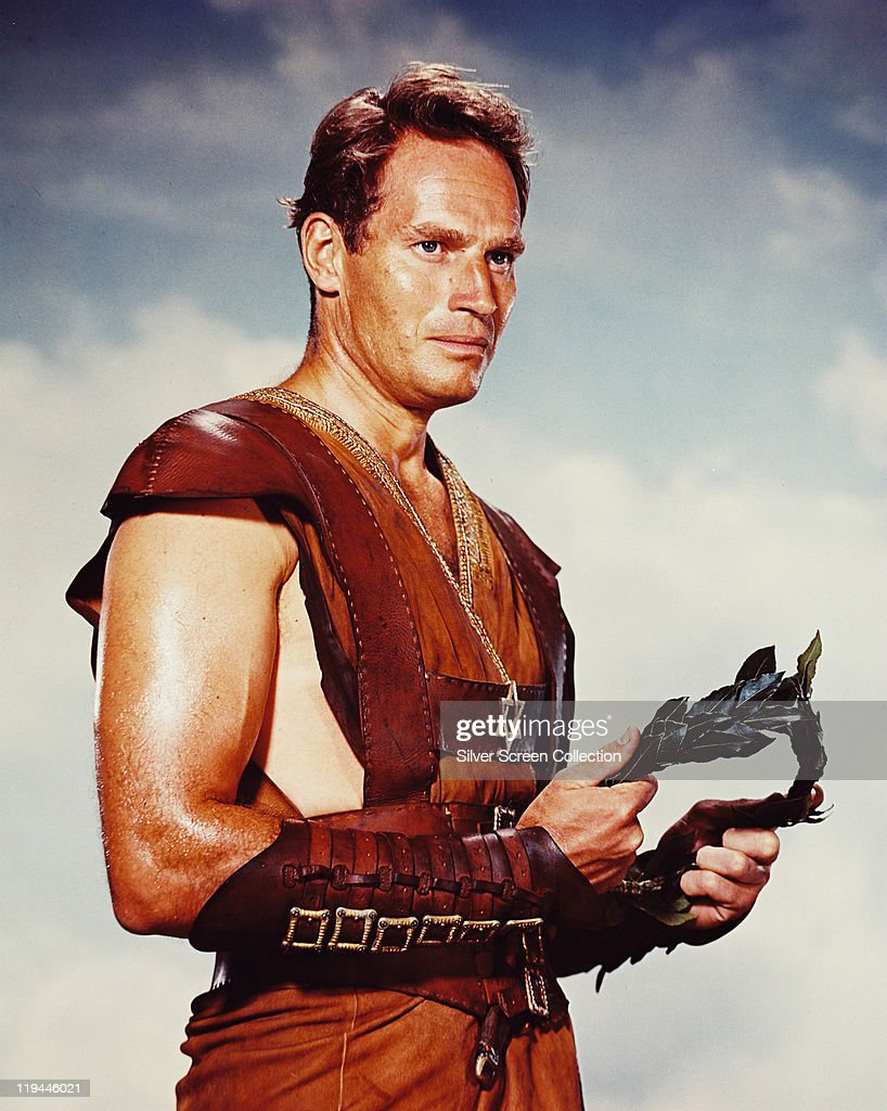 Charlton Heston (1923–2008), US actor, in costume holding a laurel wreath in a publicity still issued for the film, 'Ben-Hur', 1959. The historical drama, directed by William Wyler (1902-1981), starred Heston as 'Judah Ben-Hur'.