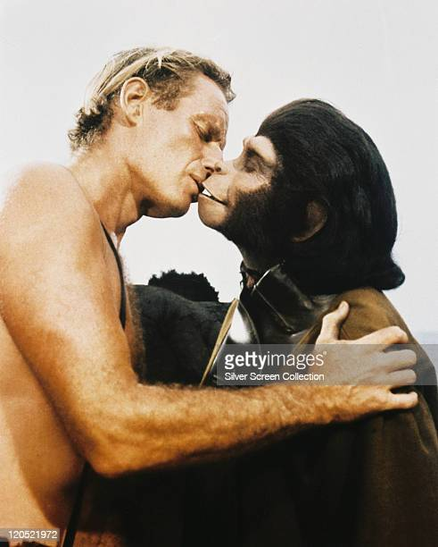 Charlton Heston US actor kissing Kim Hunter who is dressed in an ape costumes in a publicity still issued for the film 'Planet of the Apes' 1968 The...