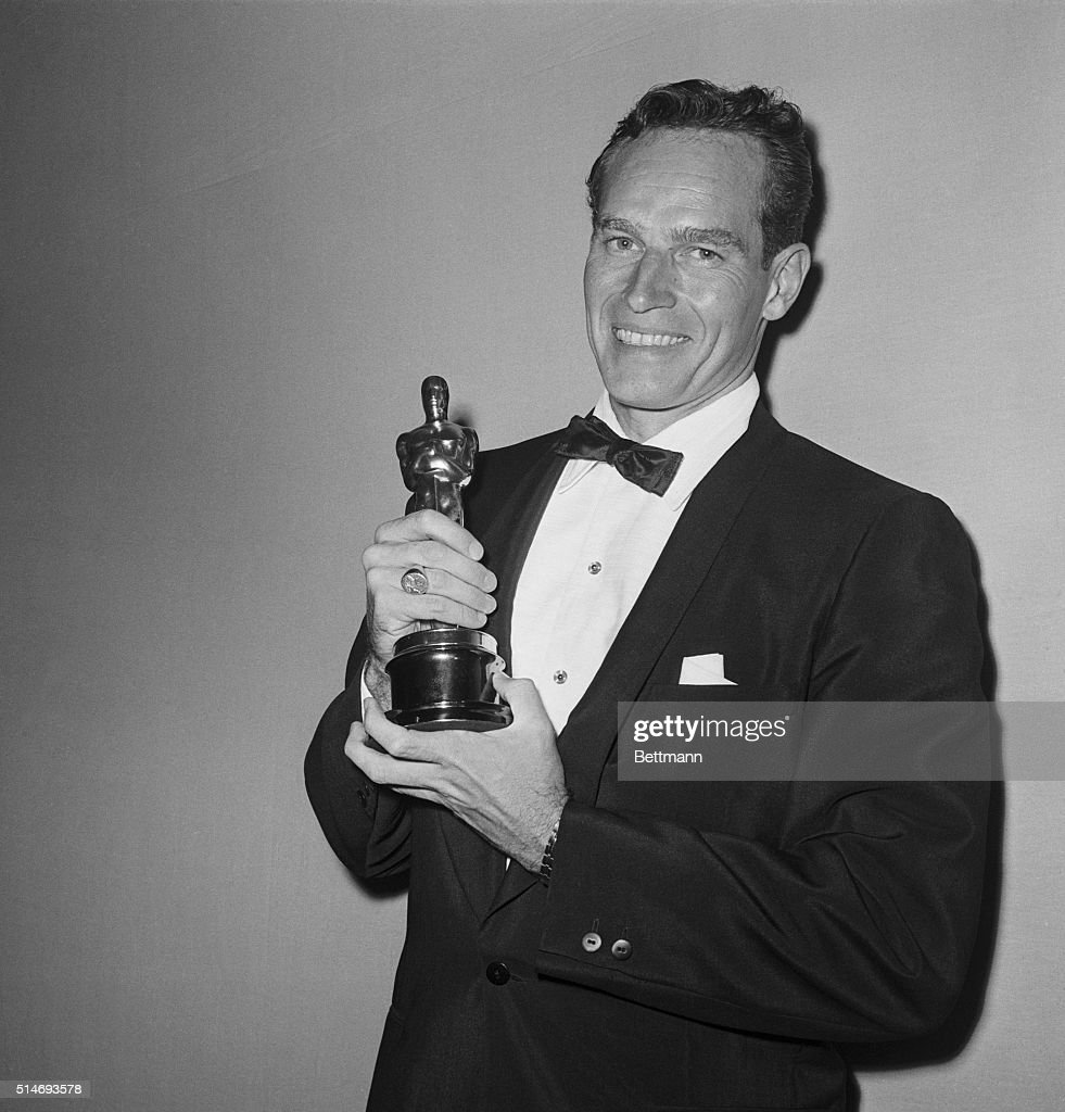Charlton Heston with the Oscar he won for Best Actor in Ben Hur, after the awards ceremony. 1960.