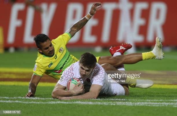 Charlton Kerr of England dives to score a try during the match between England and Australia on day two of the Emirates Airline Dubai Rugby Sevens -...