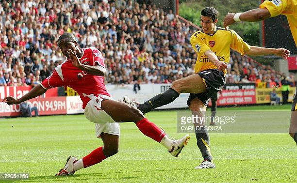 Arsenal's Robin Van Persie scores past Charlton's Kevin Lisbie during their Premiership football match at home to Charlton 30 Sptember 2006 AFP...