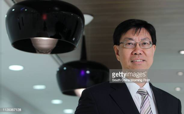 Charlton Wong Executive Vice President of AECOM pose for photographer in his office in Shatin 22JUN12