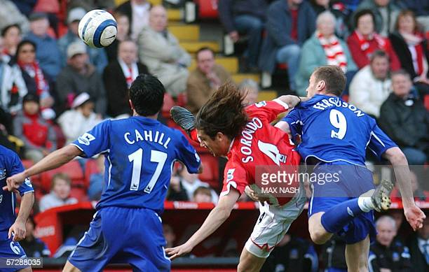 Charlton's Gonzalo Sorondo is caught between Everton's Tim Cahill and Duncan Ferguson as they vie for the ball during the English Premiership soccer...