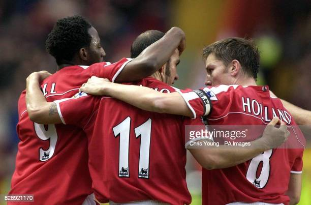 Charlton's Jason Euell celebrates his first half goal against Wolverhampton Wanderers with team-mates Paolo Di Canio and Matt Holland, during the...