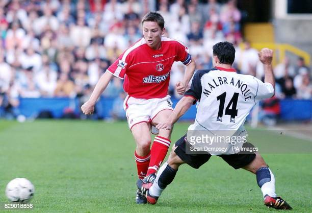 Charlton's Matt Holland tackles Fulham's Steed Malbranque during their Barclaycard Premiership match at Craven Cottage, London. THIS PICTURE CAN ONLY...