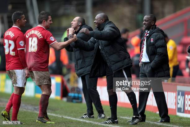 Charlton's Yann Kermorgant celebrates his goal with Alex Dyer and manager Chris Powell during the Sky Bet Championship match at The Valley London