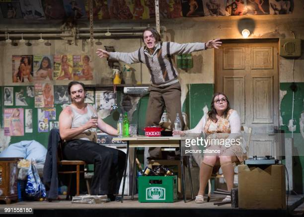 Charly Hubner Michael Weber and Bettina Stucky performing onstage during a photo rehearsal of the play The Golden Glove in the Schauspielhaus theatre...