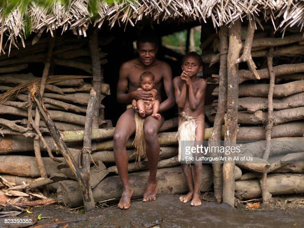 Charly Kala and his nephews from the Big Nambas tribe in front of their house Tanna island Yakel Vanuatu on September 6 2007 in Yakel Vanuatu