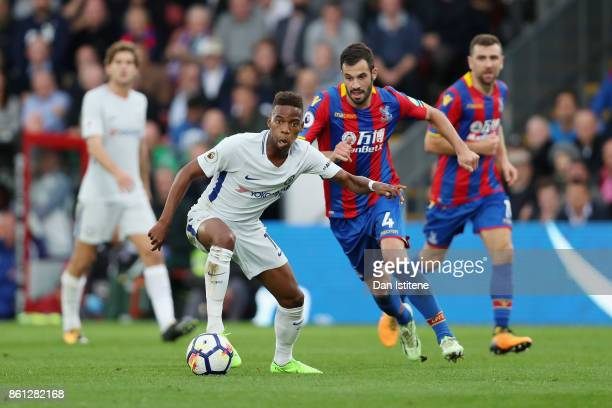 Charly Musonda of Chelsea and Luka Milivojevic of Crystal Palace battle for possession during the Premier League match between Crystal Palace and...