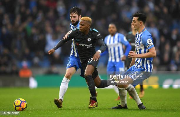 Charly Musonda of Chelsea attempts to get past Davy Propper of Brighton and Hove Albion and Lewis Dunk of Brighton and Hove Albion during the Premier...