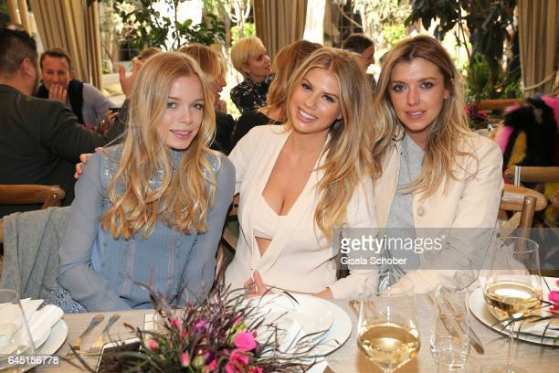 Charly Sturm Charlotte McKinney and Caitlin Chapman during the NetAPorter lunch at hotel Chateau Marmont on February 24 2017 in Los Angeles California