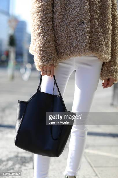 Charly Sturm wearing Closed pants and jacket, Stella McCartney bag, Chromehearts and Maria Tash earrings, Margova, Cartier and Sophie by Sophie rings...