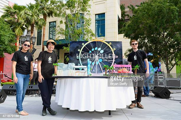 Charm City Cakes designers Jackie Ordonez Melody Hirose and Mark Muller pose with the replica of the High Roller observation wheel made of cake by...