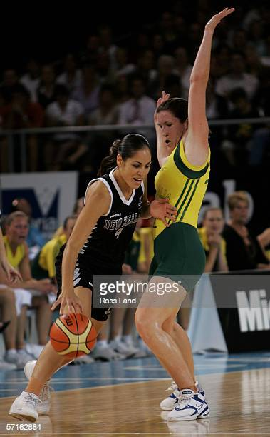 Charmain Purcell of New Zealand drives past the Australian defence during the gold medal basketball match between Australia and New Zealand at the...