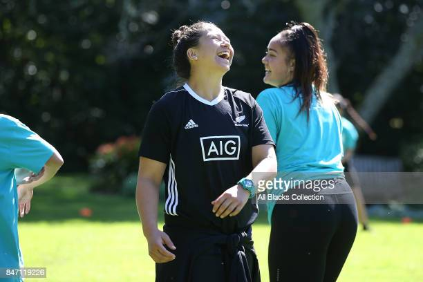 Charmaine McMenamin of the Black Ferns coaches students during a meet and greet with the Governor General at Government House on September 15, 2017...