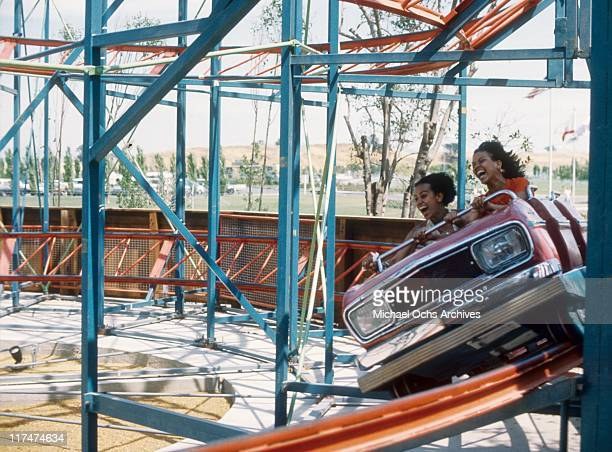 Charmaine Sylvers and Olympia Sylvers of the R and B group The Sylvers on a roller coaster at Magic Mountain on June 22 1973 in Valencia California