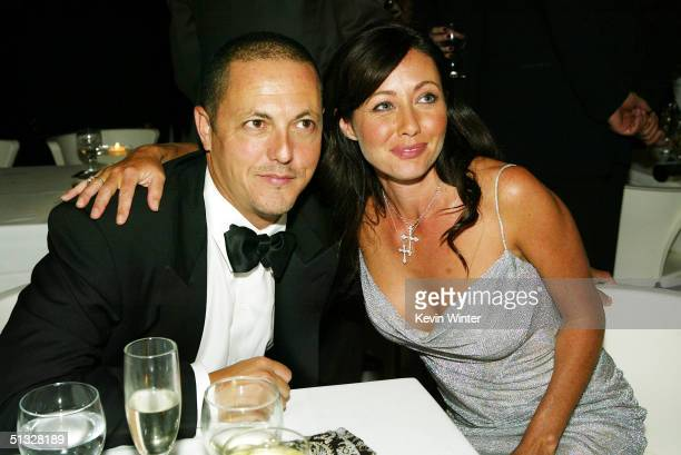 Charmed creator Bert Salke and actress Shannen Doherty pose at the FOX 56th Annual Primetime Awards Gala at Spago September 19 2004 in Beverly Hills...