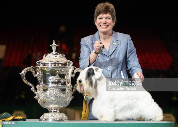 Charmin, the Sealyham Terrier and his handler Margery Good celebrate after winning 'Best in Show' at the 2009 Crufts dog show on March 8, 2009 in...
