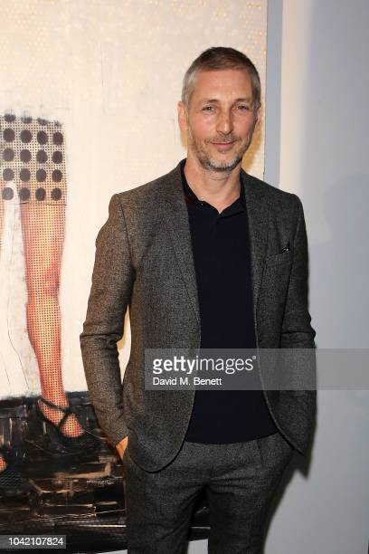 Charming Baker attends a private view of So It Goes by artist Charming Baker at The Vinyl Factory on September 27 2018 in London England