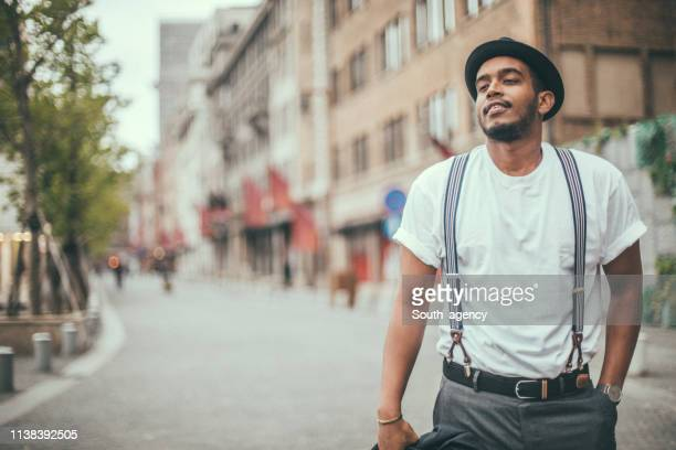charming black guy in city - suspenders stock pictures, royalty-free photos & images