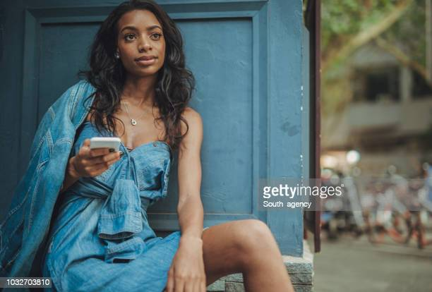 charming black lady - denim dress stock photos and pictures