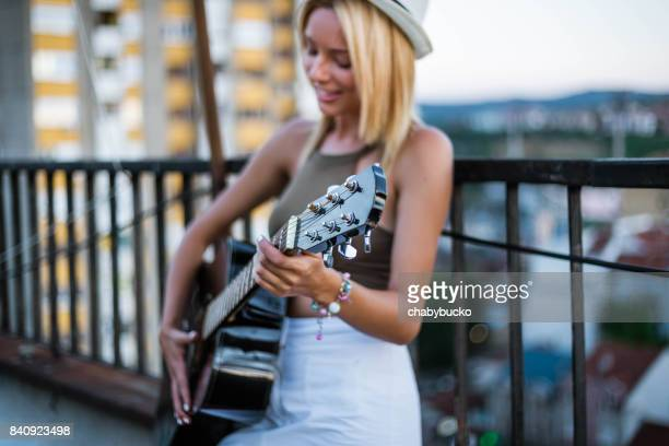 Charming blonde playing guitar
