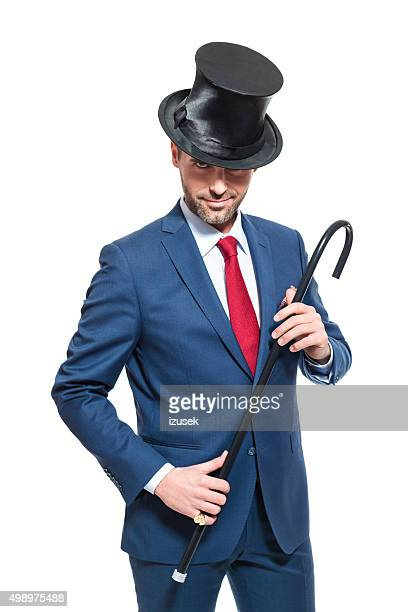 Charming businessman wearing suit and cylinder hat