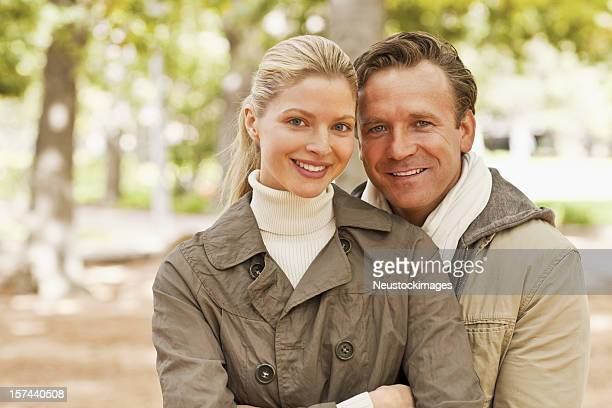 Charming couple standing together at the park