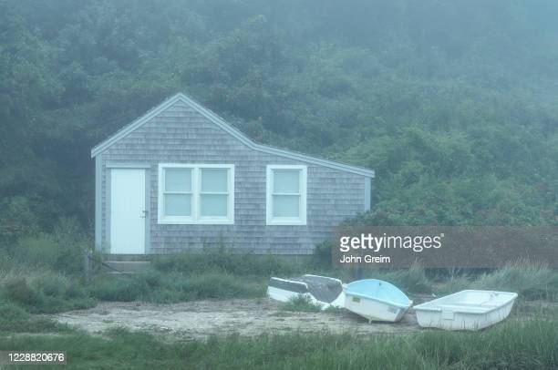 Charming fishing shack cottage in morning mist
