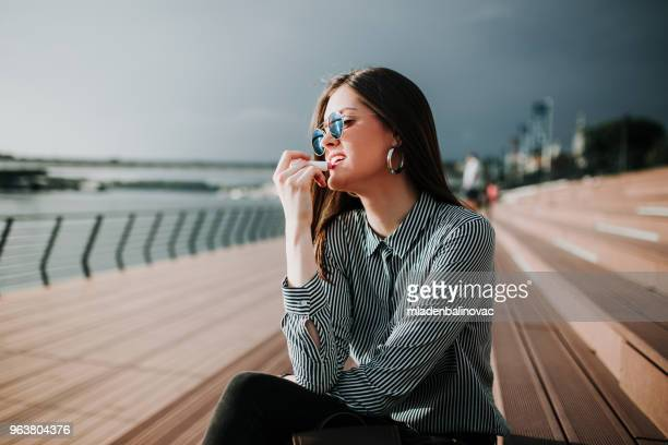 charming girl by the river - lip balm stock pictures, royalty-free photos & images